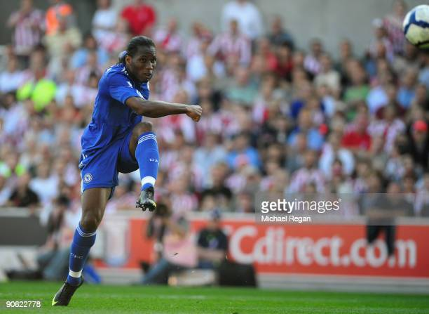 Didier Drogba of Chelsea scores his team's first goal during the Barclays Premier League match between Stoke City and Chelsea at the Britannia...