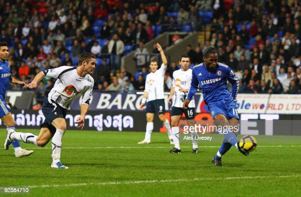 Didier Drogba of Chelsea scores the fourth goal during the Barclays Premier League match between Bolton Wanderers and Chelsea at the Reebok Stadium...
