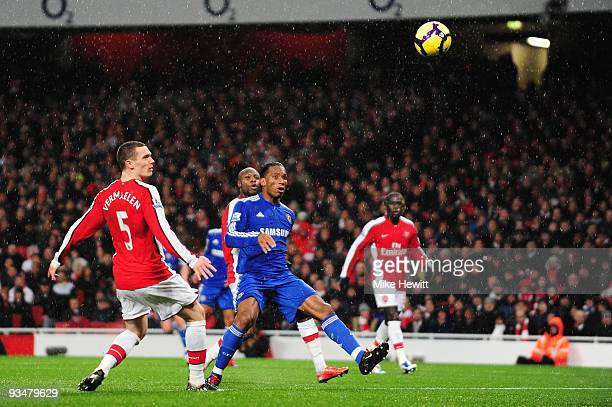 Didier Drogba of Chelsea scores the opening goal during the Barclays Premier League match between Arsenal and Chelsea at the Emirates Stadium on...