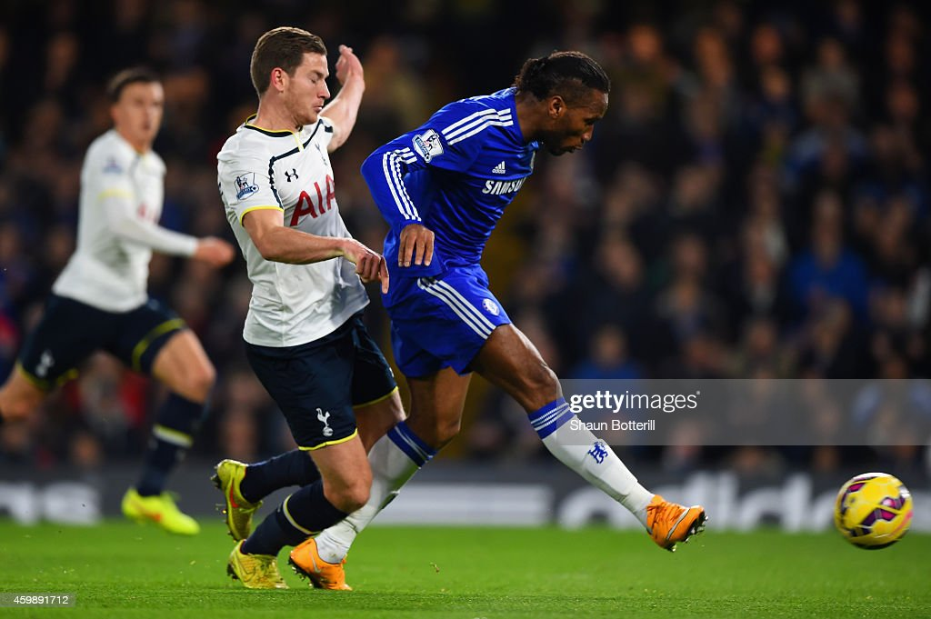 Didier Drogba of Chelsea scores their second goal under pressure from Jan Vertonghen of Spurs during the Barclays Premier League match between Chelsea and Tottenham Hotspur at Stamford Bridge on December 3, 2014 in London, England.