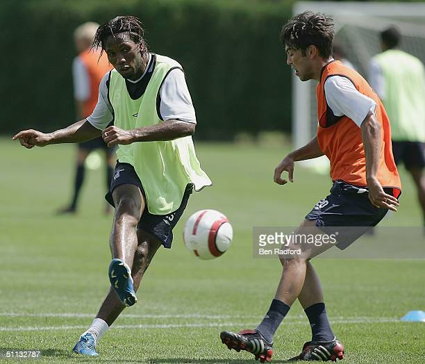 Didier Drogba of Chelsea shoots as Paulo Ferreira defends during Chelsea preseason training at The Novacare Centre on July 31 2004 in Philadelphia...