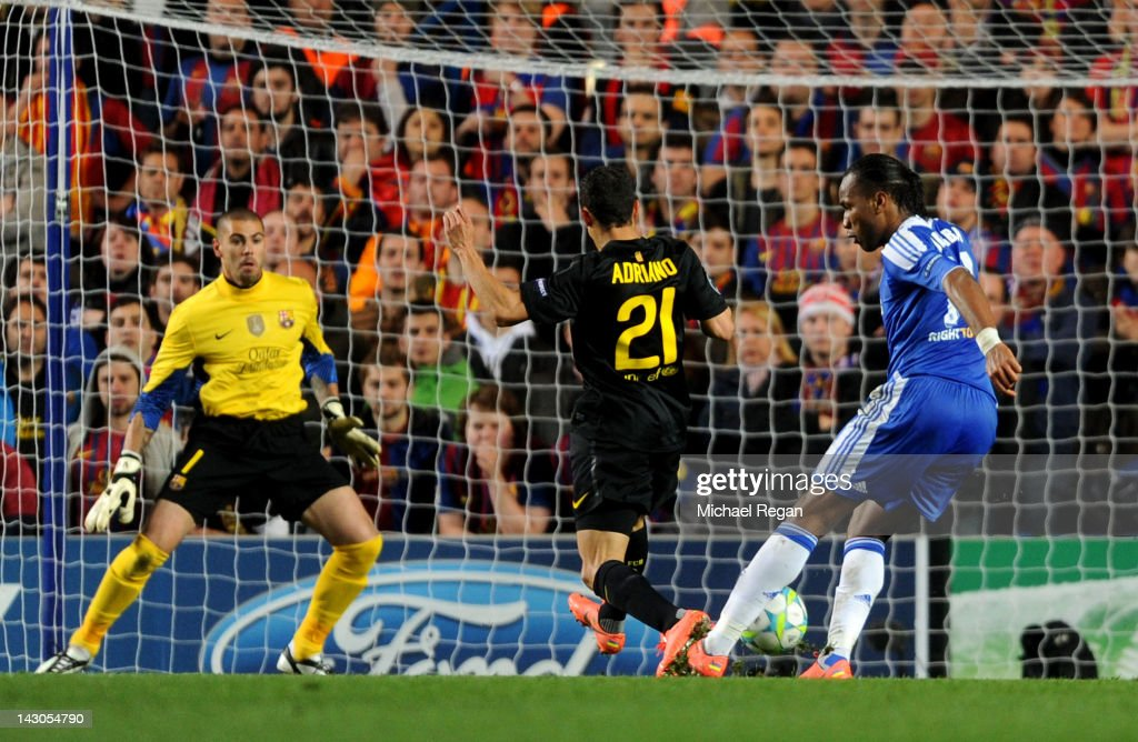 Didier Drogba of Chelsea shoots past Adriano Correia #21 and goalkeeper Victor Valdes of Barcelona to score the opening goal during the UEFA Champions League Semi Final first leg match between Chelsea and Barcelona at Stamford Bridge on April 18, 2012 in London, England.