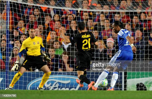 Didier Drogba of Chelsea shoots past Adriano Correia and goalkeeper Victor Valdes of Barcelona to score the opening goal during the UEFA Champions...
