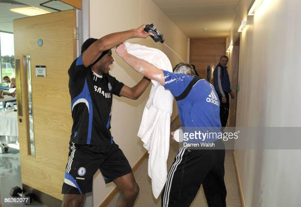 Didier Drogba of Chelsea squirts massage cream at Billy after a training session at the training ground on March 05, 2009 in Cobham, United Kingdom