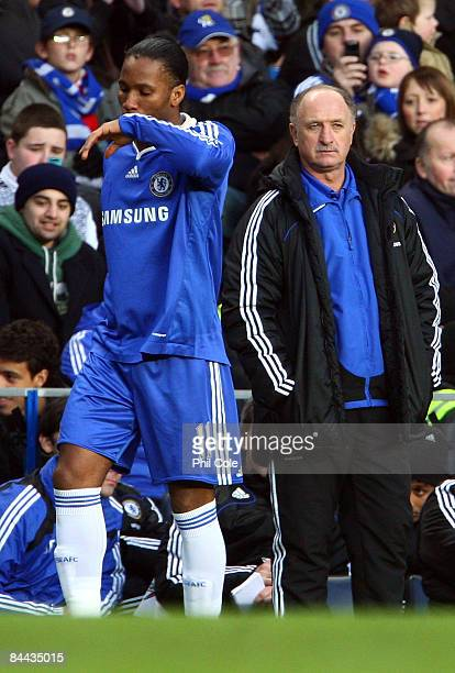 Didier Drogba of Chelsea stands next to Chelsea manager Luiz Felipe Scolari during the FA Cup fourth-round match between Chelsea and Ipswich Town at...