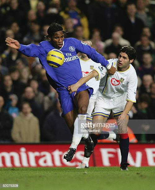 Didier Drogba of Chelsea tangles with Dejan Stefanovic of Portsmouth during the Barclays Premiership match between Chelsea and Portsmouth at Stamford...