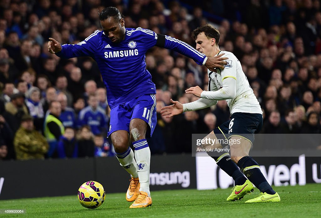 Didier Drogba (L) of Chelsea vies with Vlad Chiriches of Tottenham Hotspur (R) during the Barclays Premier League match between Chelsea and Tottenham Hotspur at Stamford Bridge in London, England on December 03, 2014.