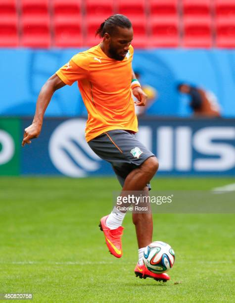 Didier Drogba of Cote D'Ivoire controls the ball during the training session ahead of the Group C match between Colombia and Cote D'Ivoire as part of...