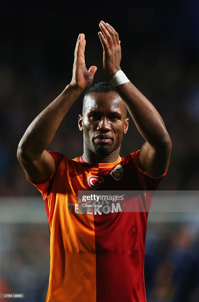 Didier Drogba of Galatasaray applauds the crowd after the UEFA Champions League Round of 16 second leg match between Chelsea and Galatasaray AS at Stamford Bridge on March 18, 2014 in London, England.