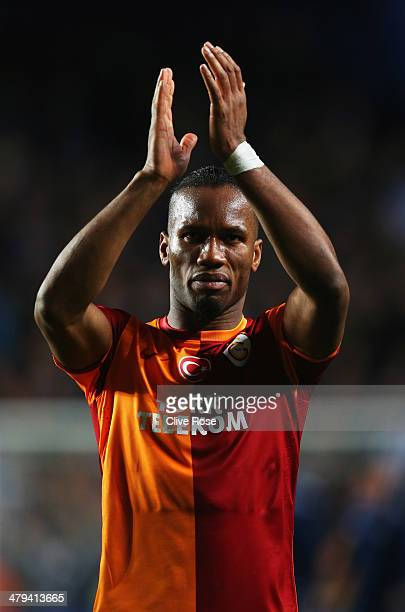 Didier Drogba of Galatasaray applauds the crowd after the UEFA Champions League Round of 16 second leg match between Chelsea and Galatasaray AS at...