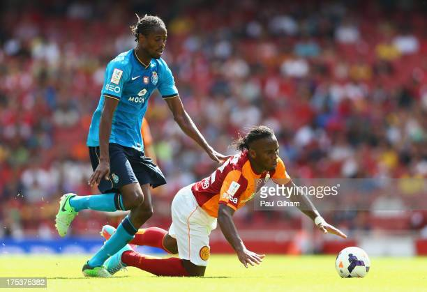 Didier Drogba of Galatasaray battles for the ball with Abdoulaye Ba of FC Porto during the match between Galatasaray and FC Porto at Emirates Stadium...