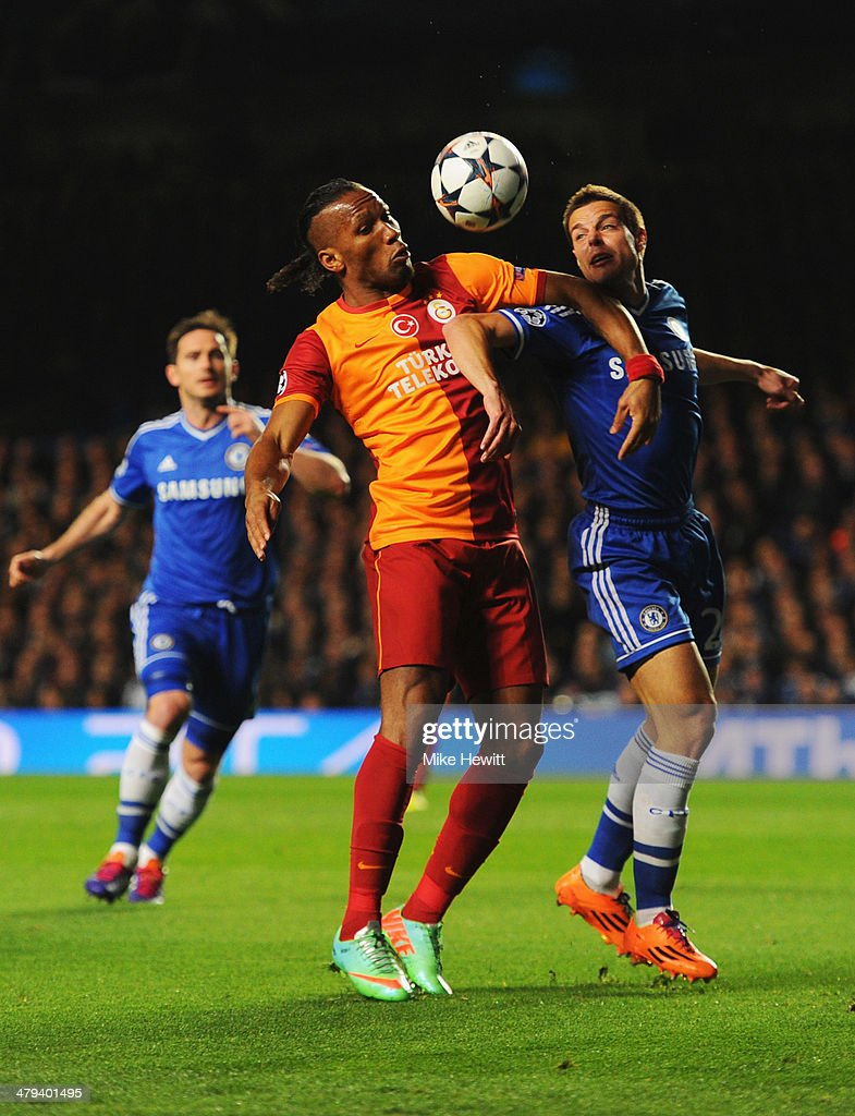 Didier Drogba of Galatasaray battles with Cesar Azpilicueta of Chelsea during the UEFA Champions League Round of 16 second leg match between Chelsea and Galatasaray AS at Stamford Bridge on March 18, 2014 in London, England.