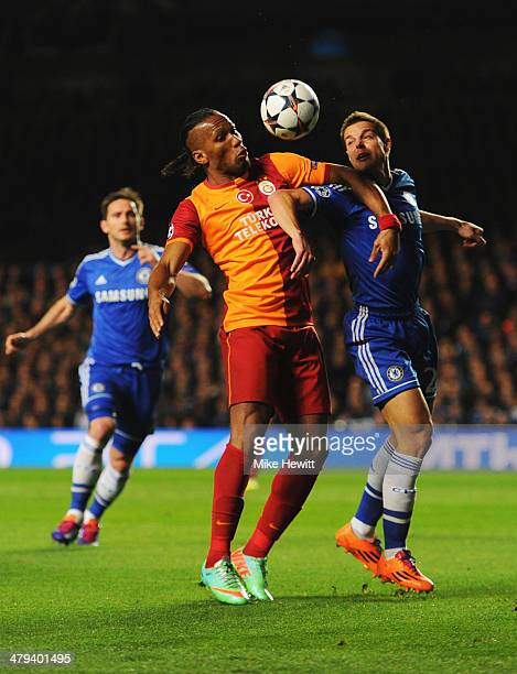 Didier Drogba of Galatasaray battles with Cesar Azpilicueta of Chelsea during the UEFA Champions League Round of 16 second leg match between Chelsea...
