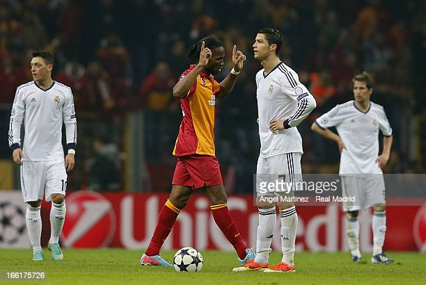 Didier Drogba of Galatasaray celebrates after scoring their third goal as Cristiano Ronaldo of Real Madrid appears dejected during the UEFA Champions...