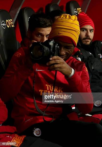 Didier Drogba of Galatasaray takes a photo by using Anadolu Agency photojournalist's camera before the Turkish Super League match between Galatasaray...