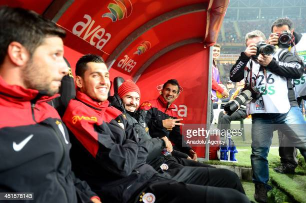 Didier Drogba of Galatasaray takes the photo of his teammates by using Anadolu Agency photojournalist's camera before the Turkish Super League match...