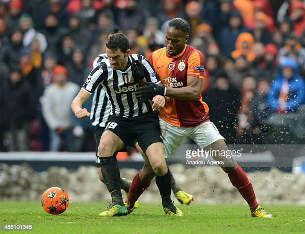 Didier Drogba of Galatasaray vies for the ball with Leonardo Bonucci of Juventus during the UEFA Champions League group B soccer match between...