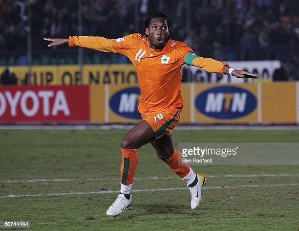 Didier Drogba of Ivory Coast celebrates scoring the winning penalty during The African Cup of Nations Quarter Final match between Cameroon v Ivory...