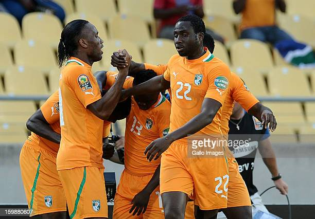 Didier Drogba of Ivory Coast celebrates with teammates after the team scored a goal during the 2013 Orange African Cup of Nations match between Ivory...