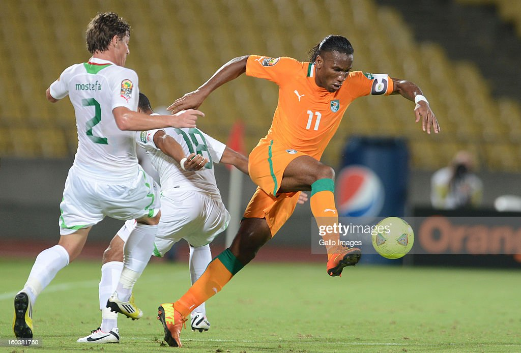 Didier Drogba of Ivory Coast competes with Mehdi Mostefa-Sbaa of Algeria during the 2013 African Cup of Nations match between Algeria and Ivory Coast at Royal Bafokeng Stadium on January 30, 2013 in Rustenburg, South Africa.