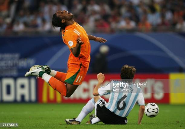 Didier Drogba of Ivory Coast is tackled by Gabriel Heinze of Argentina during the FIFA World Cup Germany 2006 Group C match between Argentina and...