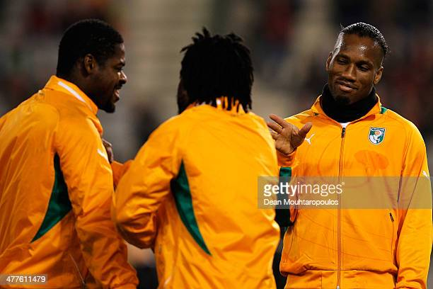 Didier Drogba of Ivory Coast jokes with team mates prior to the International Friendly match between Belgium and Ivory Coast at The King Baudouin...