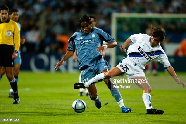 Didier Drogba of Marseille and Matias Almeyda of Inter during the UEFA Cup Quarter Final First Leg match between Marseille and Inter at Velodrome...