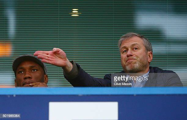 Didier Drogba of Montreal Impact and Chelsea owner Roman Abramovich are seen on the stand prior to the Barclays Premier League match between Chelsea...