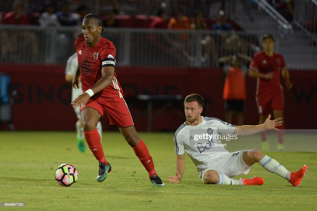 Didier Drogba #11 of Phoenix Rising FC dribbles by Ben McKendry #30 of Vancouver Whitecaps II in the second half of the match at Phoenix Rising Soccer Complex on June 10, 2017 in Phoenix, Arizona. The Phoenix Rising FC won 2-1.