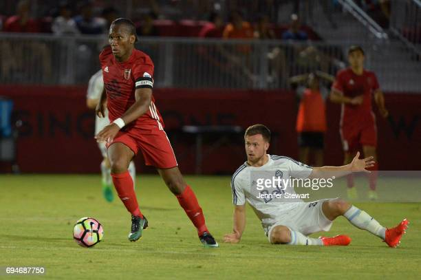 Didier Drogba of Phoenix Rising FC dribbles by Ben McKendry of Vancouver Whitecaps II in the second half of the match at Phoenix Rising Soccer...