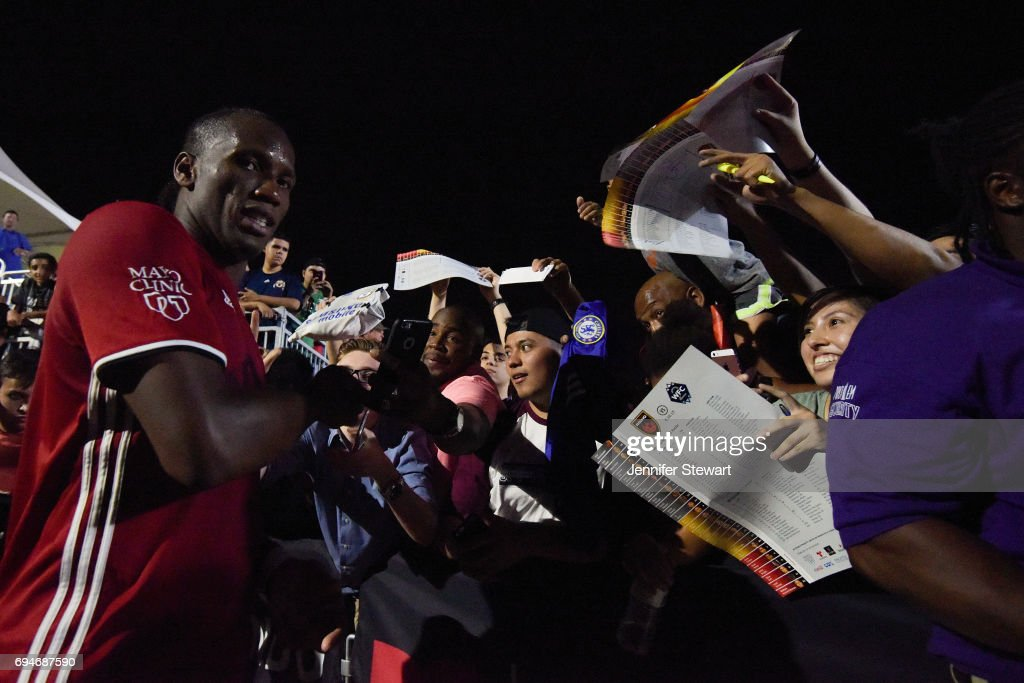 Didier Drogba #11 of Phoenix Rising FC signs autographs for fans after the game against the Vancouver Whitecaps II through fans at Phoenix Rising Soccer Complex on June 10, 2017 in Phoenix, Arizona. The Phoenix Rising FC won 2-1.