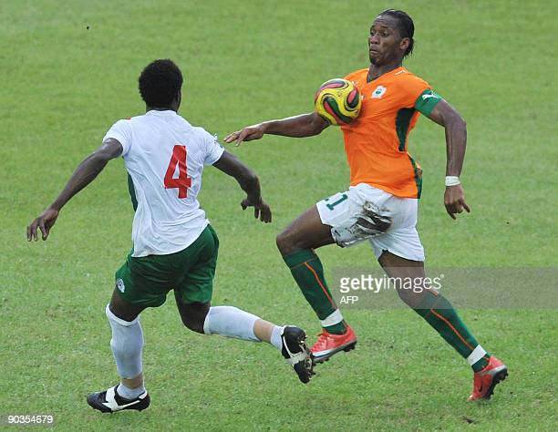 Didier Drogba of 'The Elephants' the Ivory Coast's national football team vies with Tall Mamadou of Burkina Faso on September 5 2009 in Abidjan...