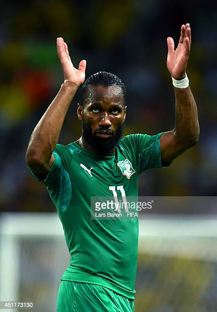 Didier Drogba of the Ivory Coast acknowledges the fans as he walks off the pitch after being replaced during the 2014 FIFA World Cup Brazil Group C...