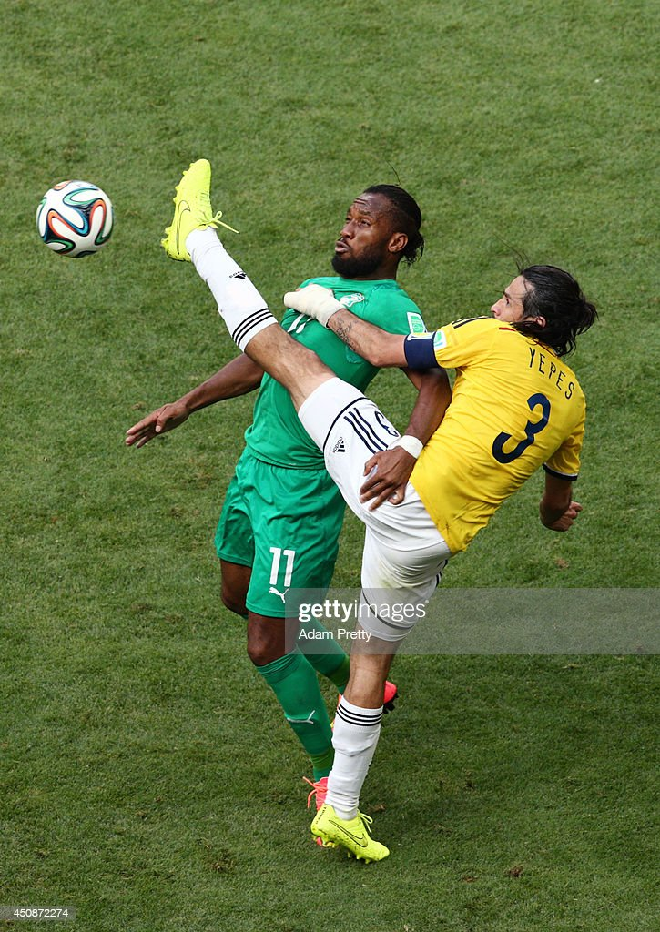 Didier Drogba of the Ivory Coast competes for the ball with Mario Yepes of Colombia during the 2014 FIFA World Cup Brazil Group C match between Colombia and Cote D'Ivoire at Estadio Nacional on June 19, 2014 in Brasilia, Brazil.