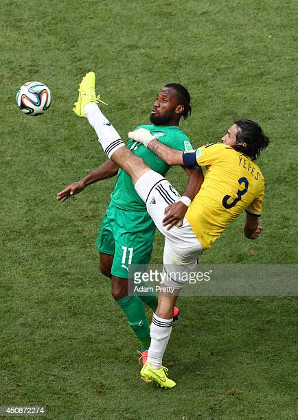 Didier Drogba of the Ivory Coast competes for the ball with Mario Yepes of Colombia during the 2014 FIFA World Cup Brazil Group C match between...