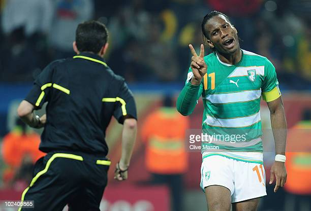 Didier Drogba of the Ivory Coast gestures to referee Alberto Undiano during the 2010 FIFA World Cup South Africa Group G match between North Korea...