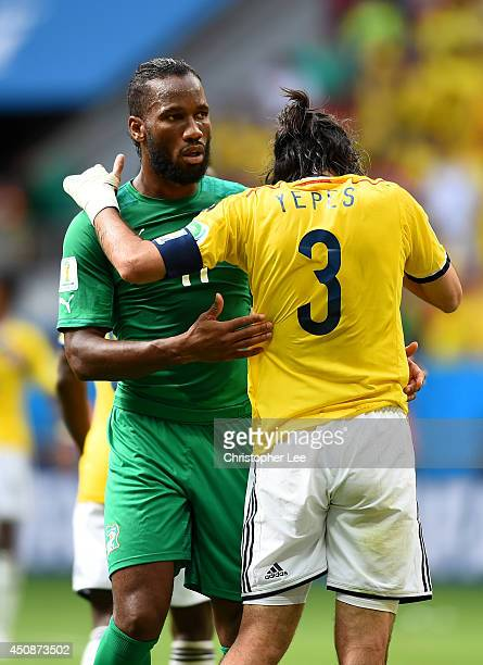 Didier Drogba of the Ivory Coast greets Mario Yepes of Colombia during the 2014 FIFA World Cup Brazil Group C match between Colombia and Cote...