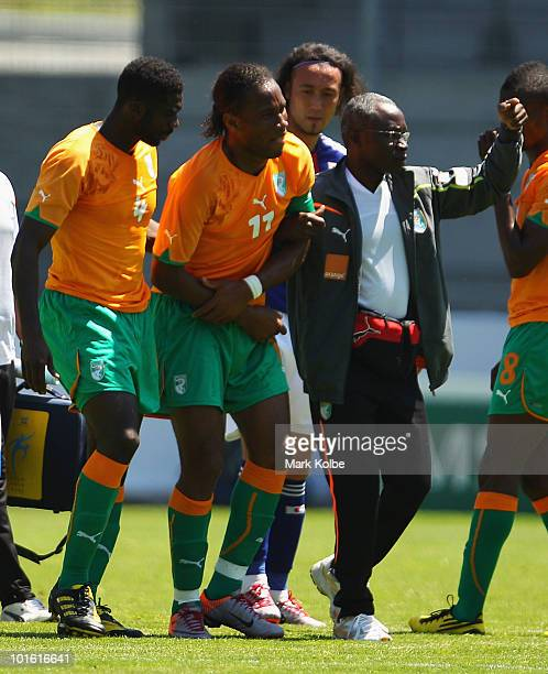 Didier Drogba of the Ivory Coast leaves the field after injuring his arm during the Japan v Ivory Coast International Friendly match at Stade de...