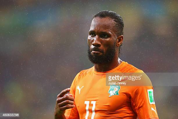Didier Drogba of the Ivory Coast looks on in the rain during the 2014 FIFA World Cup Brazil Group C match between the Ivory Coast and Japan at Arena...
