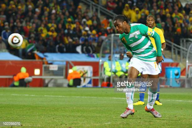 Didier Drogba of the Ivory Coast scores his side's first goal during the 2010 FIFA World Cup South Africa Group G match between Brazil and Ivory...