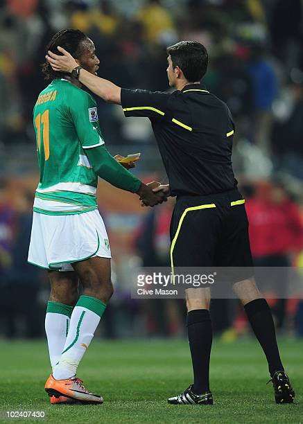 Didier Drogba of the Ivory Coast shakes hands with referee Alberto Undiano after the 2010 FIFA World Cup South Africa Group G match between North...