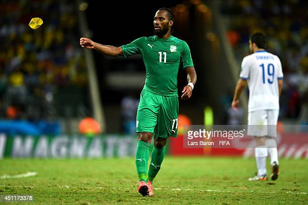Didier Drogba of the Ivory Coast throws his captaion's armband as he is replaced during the 2014 FIFA World Cup Brazil Group C match between Greece...