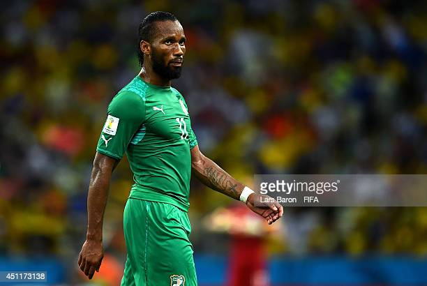Didier Drogba of the Ivory Coast walks off the pitch after being replaced during the 2014 FIFA World Cup Brazil Group C match between Greece and Cote...