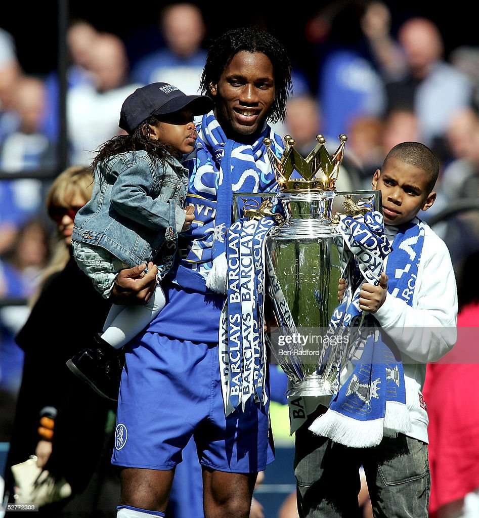 Didier Drogba poses with his children and the Barclays Premiership Trophy at Stamford Bridge on May 7, 2005 in London, England.