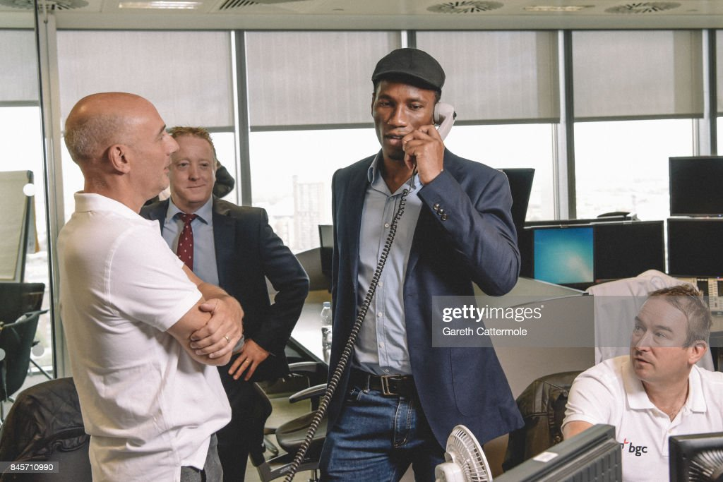 Didier Drogba representing the Didier Drogba Foundation, makes a trade with BGC traders on September 11, 2017 in Canary Wharf, London, United Kingdom.