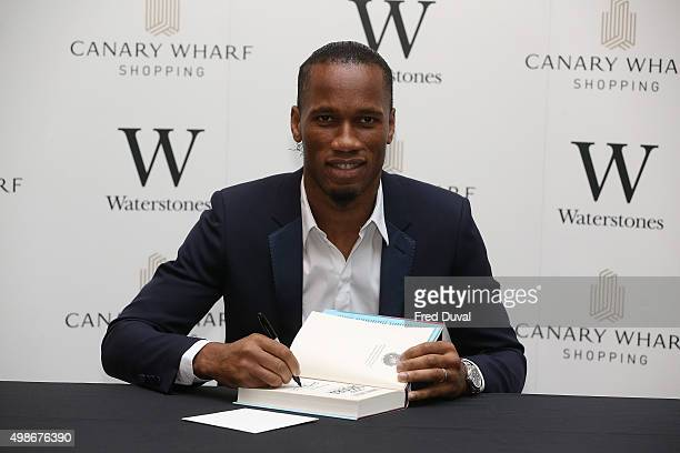 Didier Drogba signs copies of his book 'Commitment' at Waterstones Canary Wharf on November 25 2015 in London England
