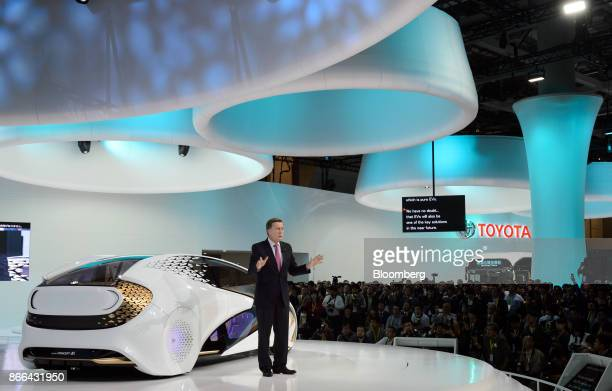 Didier Leroy executive vice president at Toyota Motor Corp speaks in front of the company's Concepti electric vehicle during a news conference at the...
