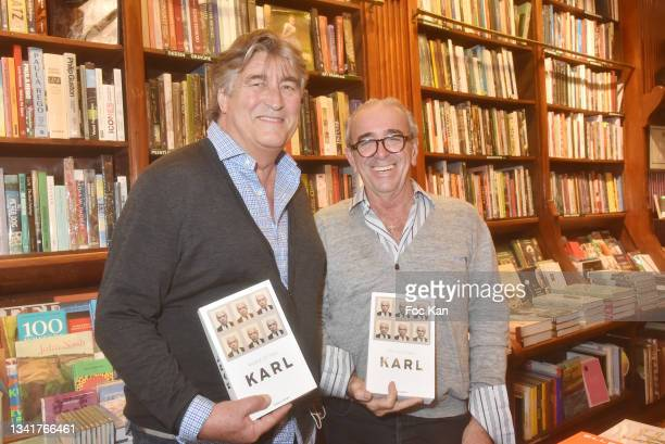 """Didier Ludot and Felix Farrington attend """"Karl"""" by Marie Ottavi Book Signing at Librairie Galignagni on September 21, 2021 in Paris, France."""