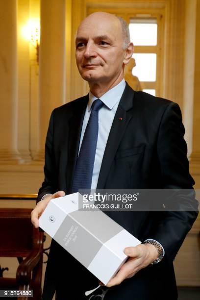 Didier Migaud president of the Court of Auditors holds the court's 2018 annual public report in Paris on February 8 2017 / AFP PHOTO / FRANCOIS...
