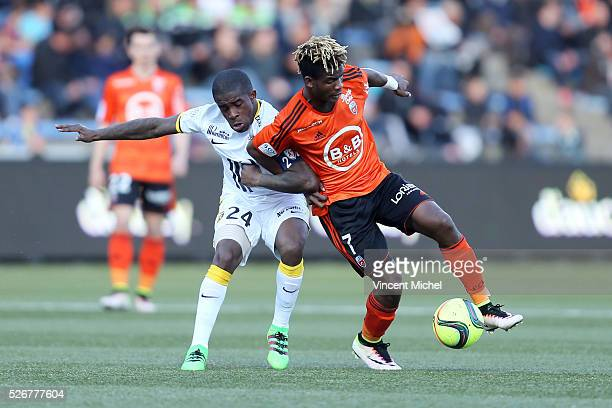 Didier NDong of Lorient and Rio Mavuba of Lille during the French Ligue 1 match between Fc Lorient and Lille OSC at Stade du Moustoir on April 30...